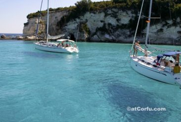 Corfu photos - in Paxos with boat