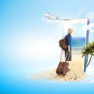 Rear view of man with hat and suitcase-bag walking to the beach